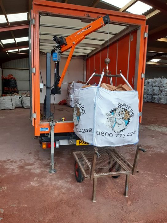 Loading a large dumpy bag into the lorry