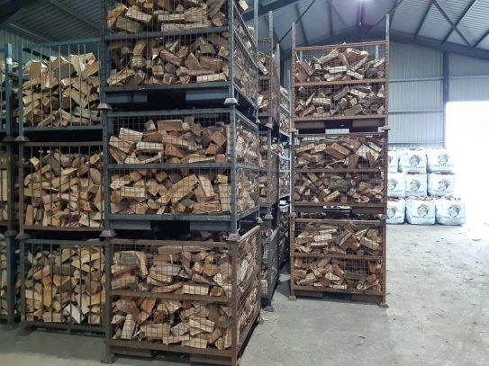 Caged logs waiting to go into the kiln