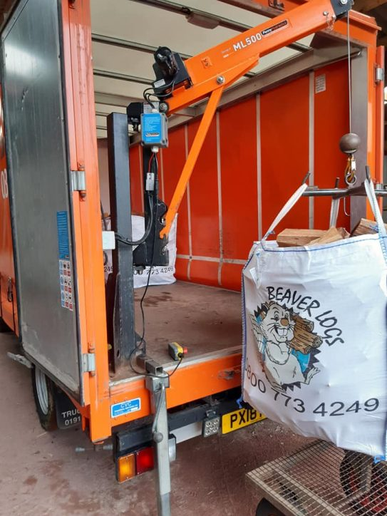 Loading a large dumpy bag into the lorry 2